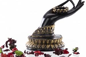 Svícen na čajovku Ruka Buddhy...