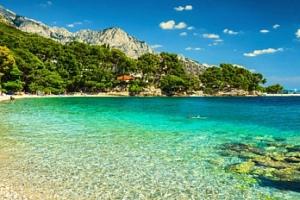 Chorvatsko - Živogošće: 8 dní pro 4 osoby v karavanu u pláže...