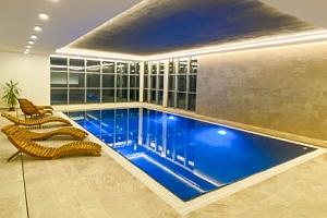 Dovolená přímo u Lipna a ski areálů: Resort Orsino s neomezeným wellness, polopenzí a bohatým…...